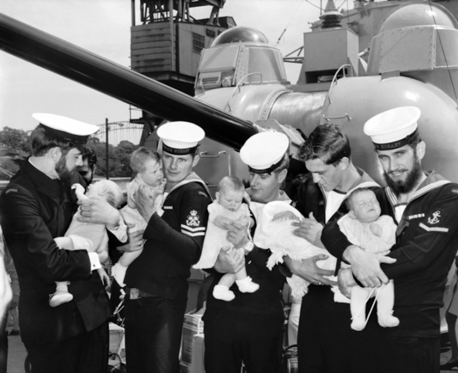 Members of HMAS Hobart (II)'s ship's company with their newborns on return from Vietnam.