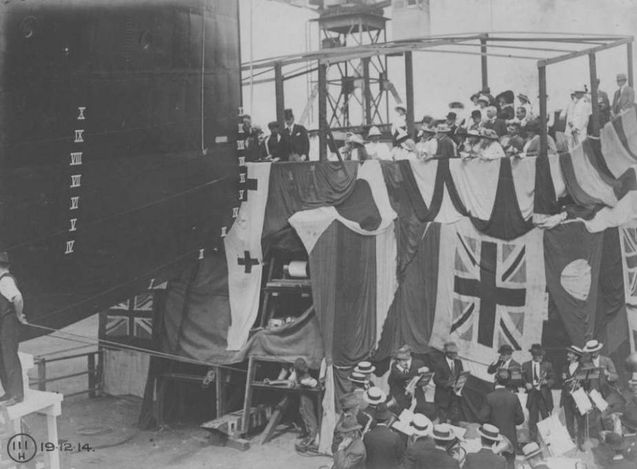 Mrs Jensen, wife of the Honourable JA Jensen, launching HMAS Huon, 19 December 1914.