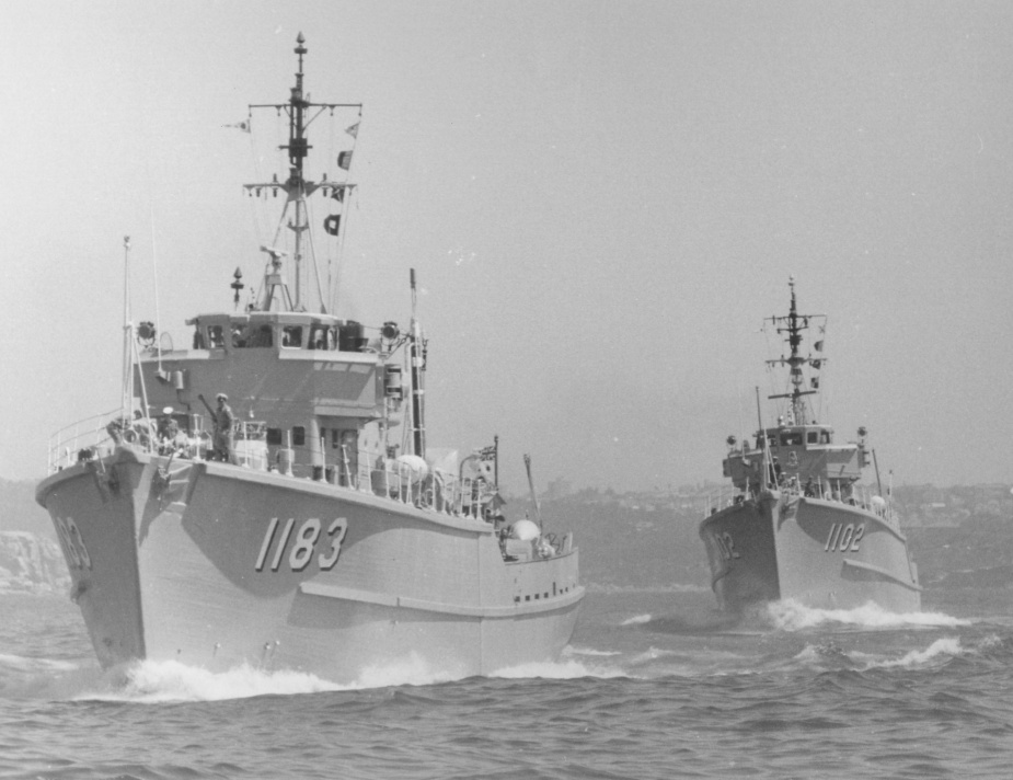 HMAS Ibis (foreground) departs Sydney in company with HMAS Snipe.