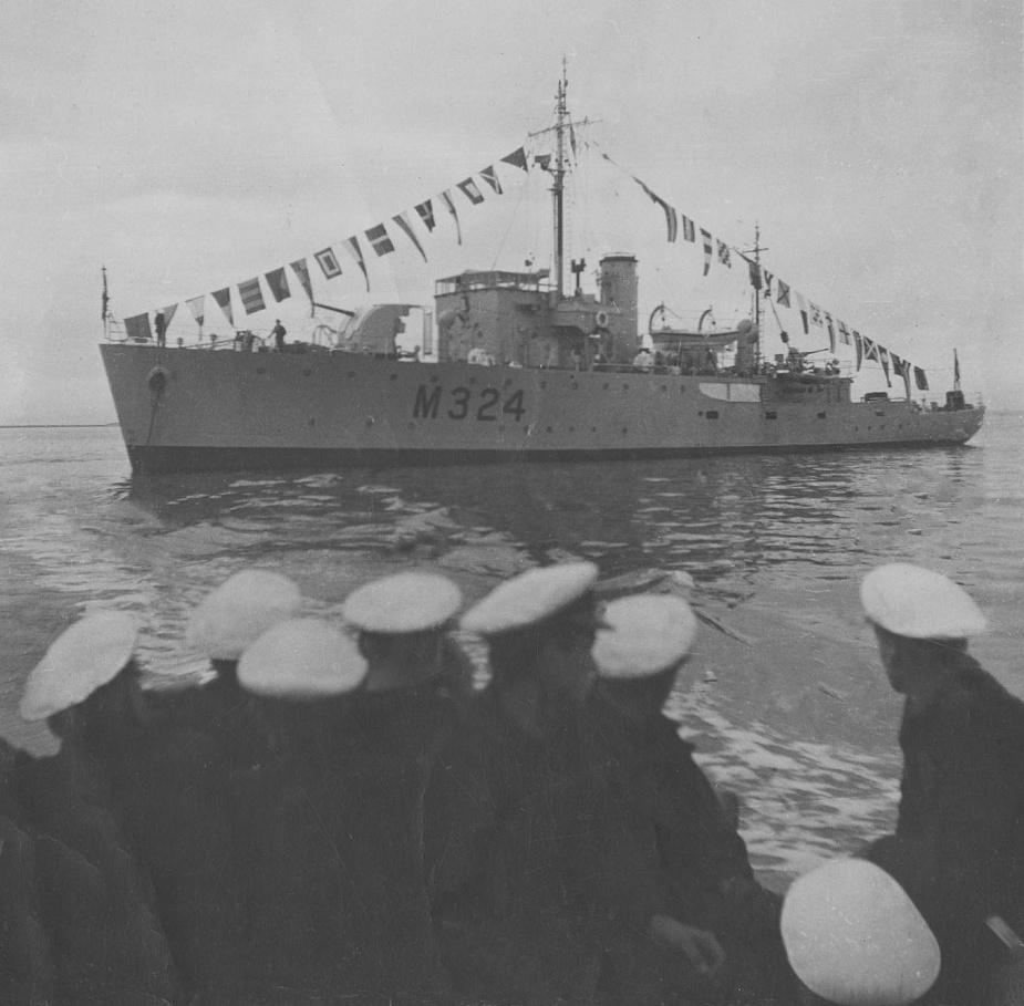 HMAS Gladstone dressed overall.