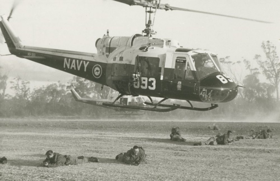 Iroquois training for an 'insertion'. The troops who have just been landed form a guard around the helicopters as the aircraft leave the drop zone.