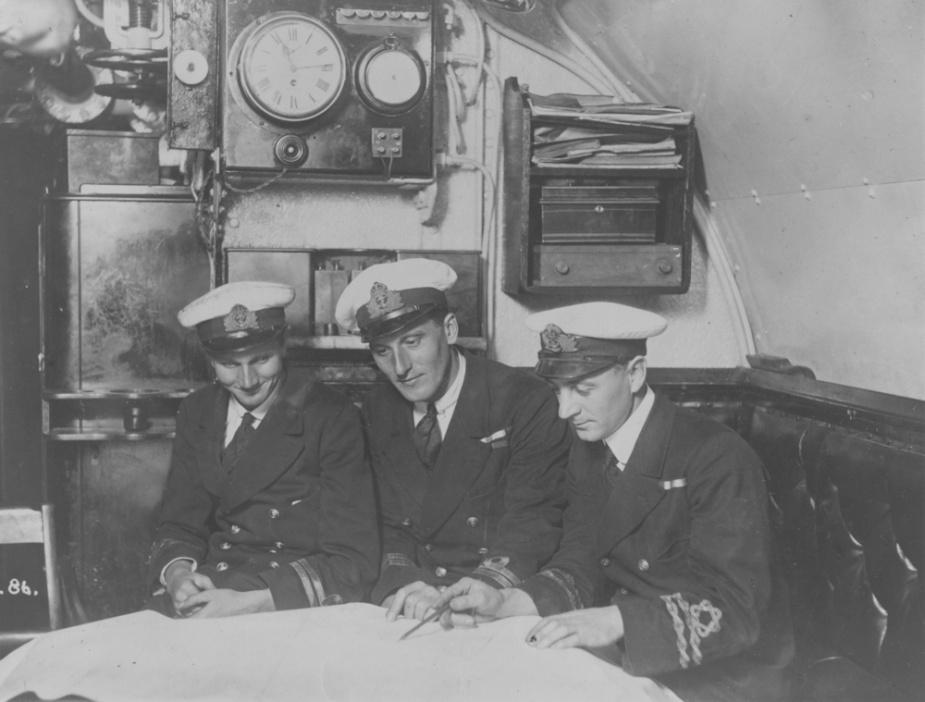 (L-R) Lieutenant C.C. Alexander, Lieutenant J.A. Peirson, DSO, and Lieutenant S Sims RANR in J5's Wardroom.
