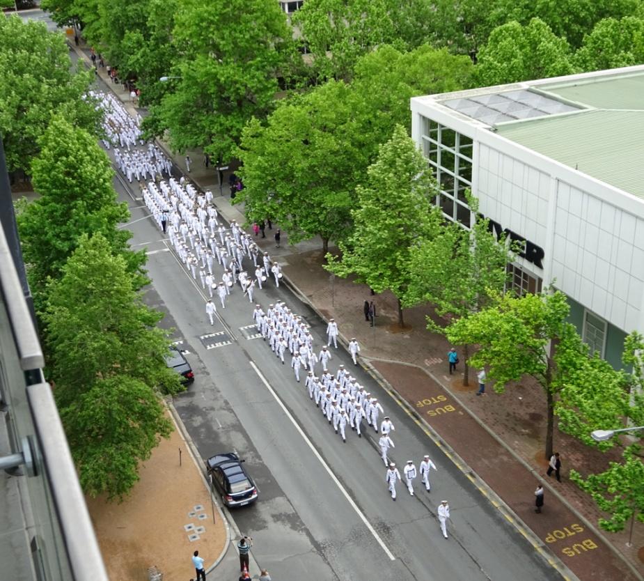 HMAS Canberra ship's company march through the streets of her namesake city (Leut John Nash).