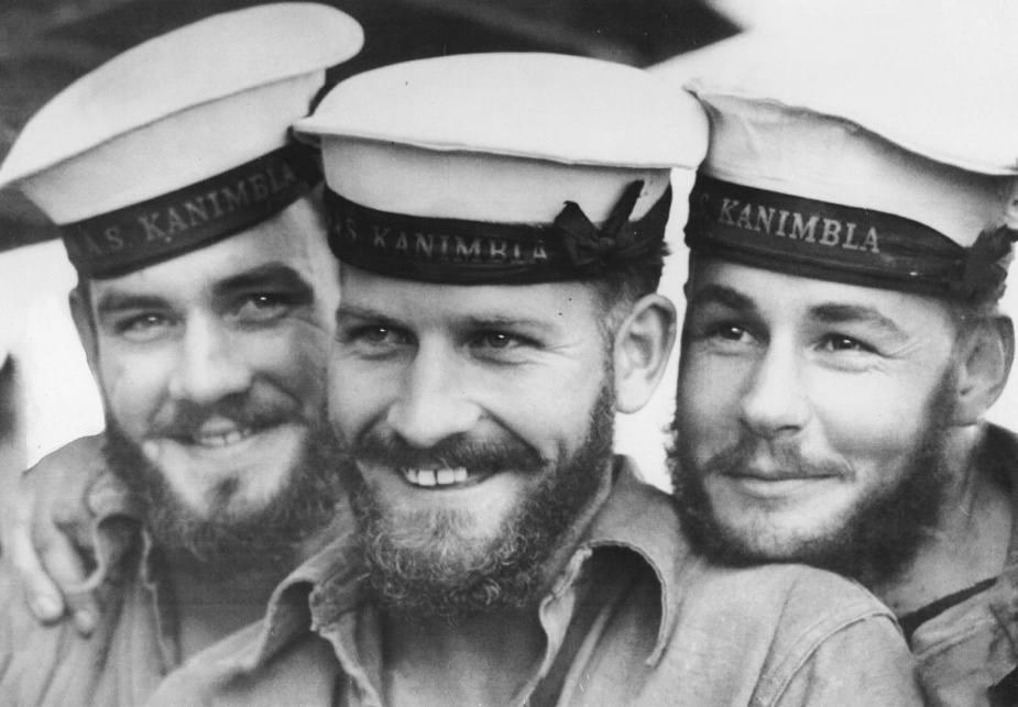 Three sailors from HMAS Kanimbla enjoying a lighter moment. If anyone has any clues as to the identity of any of the trio, please contact the Naval History Section at navy.history@defence.gov.au. (Jan Lewis collection)