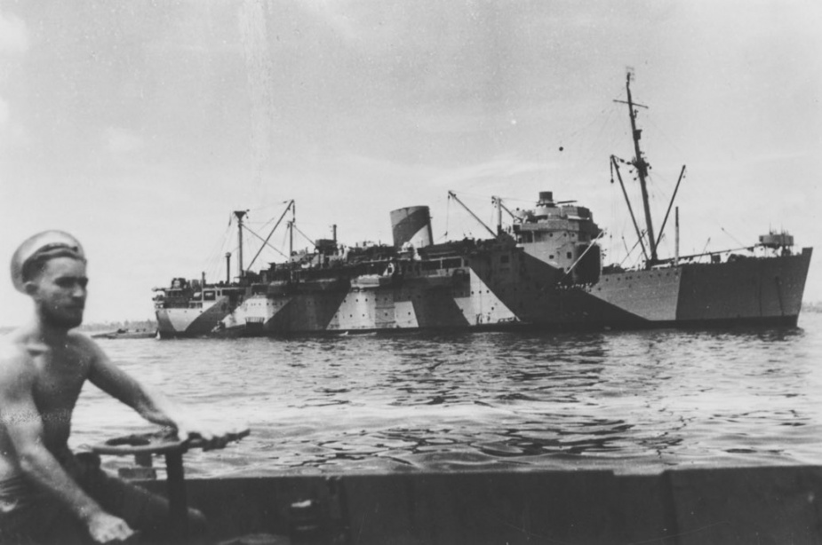 A rating returning to Kanimbla after ferrying troops ashore during landing and resupply operations.