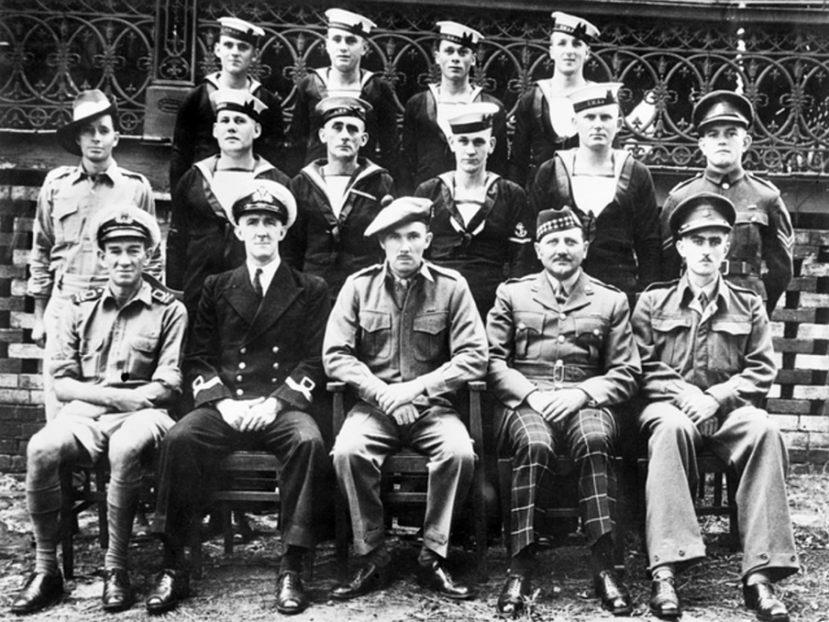 The crew of Krait and operatives of Operation JAYWICK. Left to right, front row: LEUT Ted Carse, LEUT Donald Davidson, MAJ Ivan Lyon, MAJ Jock Campbell (did not accompany the expedition), LT Robert Page. MIddle row: CPL Andrew Crilly, LS Kevin Cain, LS James McDowell, L.TEL Horrie Young, AB Walter Falls, CPL Ron Morris. Back row: ABs Moss Berryman, Frederic Marsh, Arthur Jones and Andrew Huston.