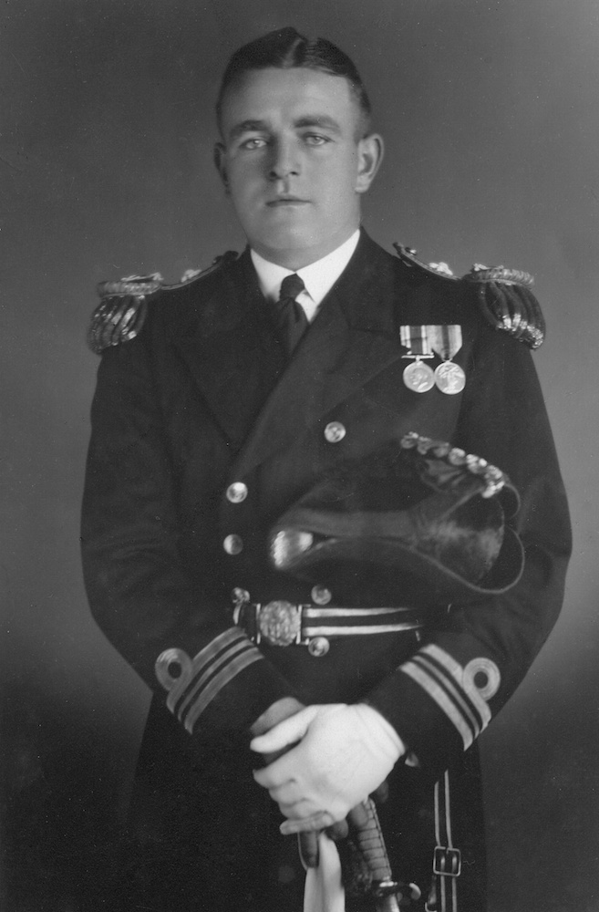 During the Battle of Savo Island, Captain Frank Getting was severely wounded but remained at his post, refusing medical treatment. He was subsequently evacuated to an American Hospital ship but later died of his wounds and was buried at sea. Getting is depicted here in the uniform of a lieutenant commander.