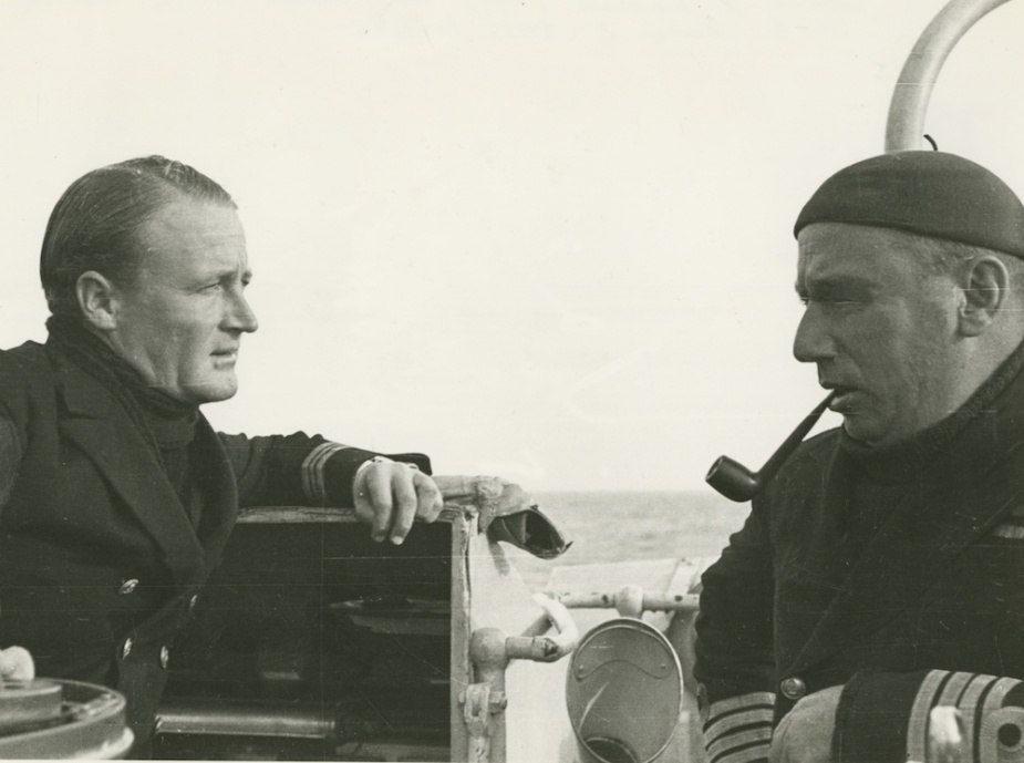 Vendetta's commanding officer Lieutenant Commander Rodney Rhoades, RAN confers with his flotilla leader, Captain H.M.L. Waller, DSO, RAN, during a lull in operations