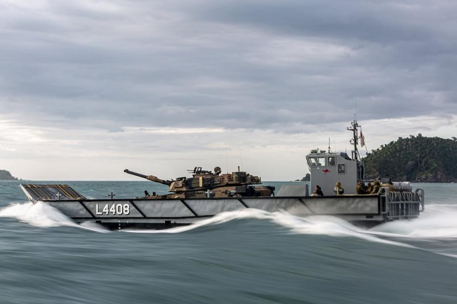 A Royal Australian Navy Light Landing Craft transports an Australian Army M1A1 Abrams main battle tank as part of load trials onboard HMAS Canberra.