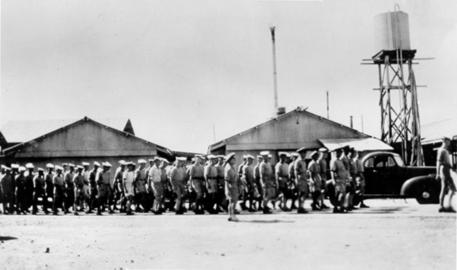The Ship's Company marching across HMAS Magnetic.