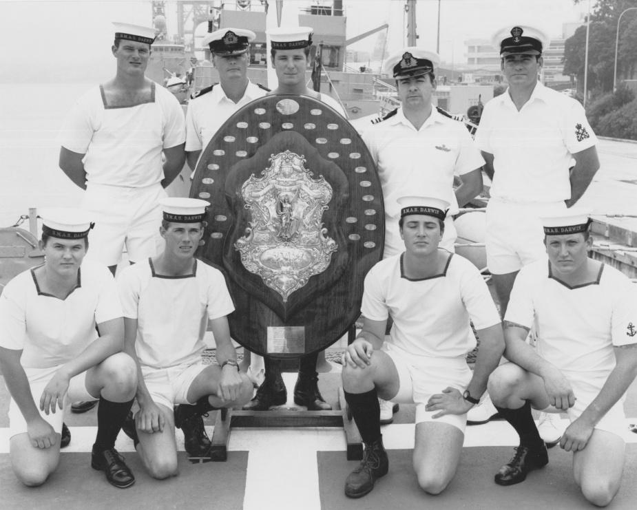 HMAS Darwin crew members pose with the Otranto Shield in 1987.