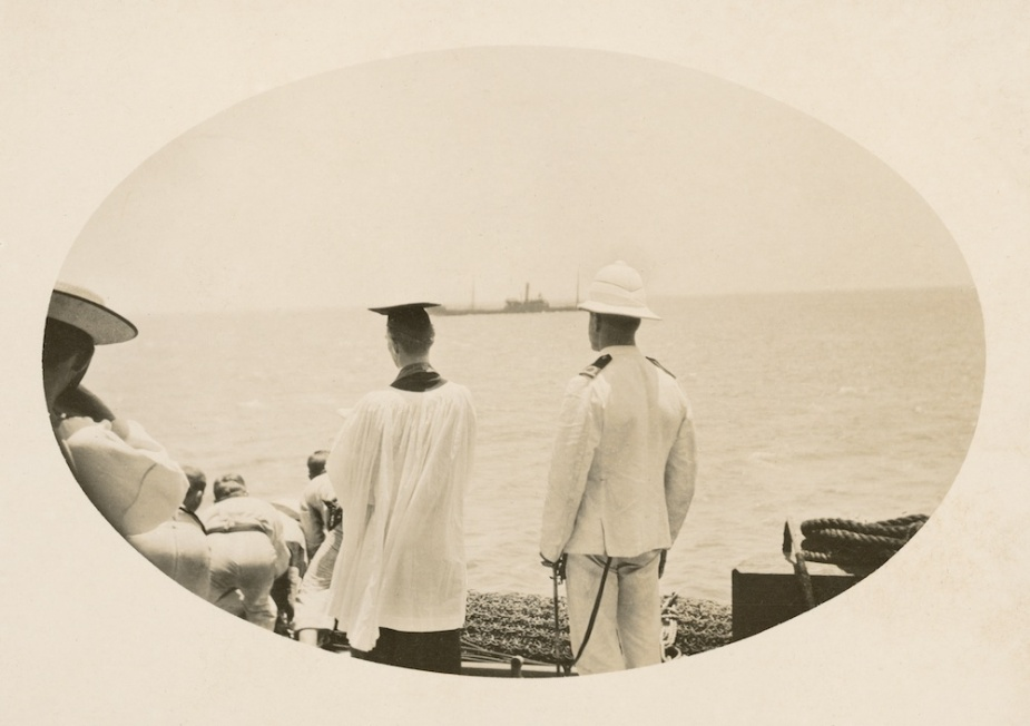 The burial at sea of Signalman R.D. Moffatt from the main deck of HMAS Australia