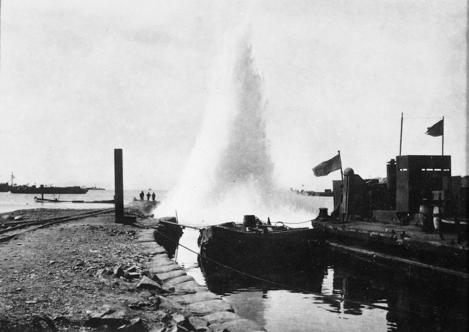 Turkish artillery bursting beside one of the piers constructed by the 1st RANBT at Suvla Bay