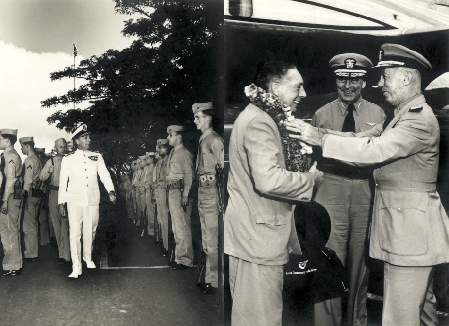 Rear Admiral John Collins being welcomed upon his arrival at Pearl Harbor.