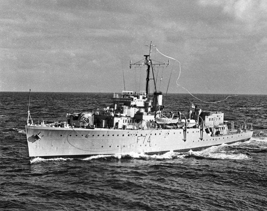 Swan flying her paying-off pennant prior to decommissioning in 1962.