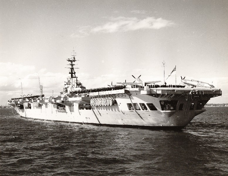 HMAS Sydney with the ship's crew and Fireflies on deck.