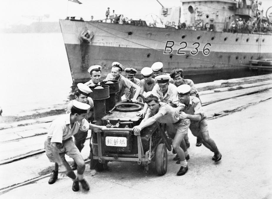 Sailors from Ballarat clear the wharf on the ship's arrival at Yokosuka Naval Base, Japan, September 1945.