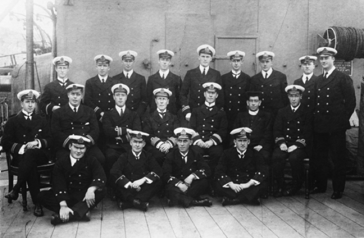 Group portrait of officers from the RAN light cruiser HMAS Sydney. The ship was on her way to the Atlantic after destroying the German raider SMS Emden at Cocos Island on 9 November 1914. Back row, left to right: Assistant Paymaster Eric Kingsford-Smith; Engineer Lieutenant Cleon Dennis; Sub Lieutenant James MC Johnstone; Artificer Engineer GA Hutchinson; Lieutenant Basil Owen Bell-Salter; Lieutenant Frederick L Cavaye; Lieutenant Rupert Clare Garsia; Dr Arthur Charles Robert Todd; Gunner Lieutenant Denis E