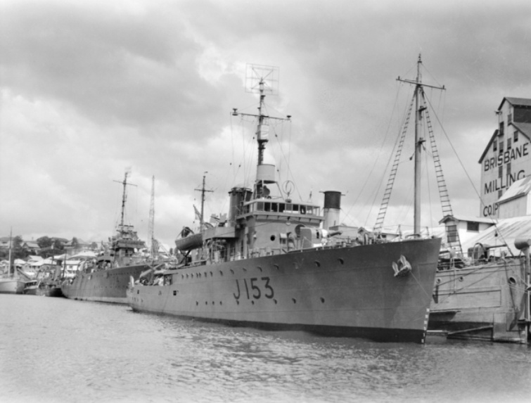 Starboard bow view of Whyalla in Brisbane, Queensland, circa 1944. Behind her is the sloop HMAS Swan. Note a SC radar is fitted to the masthead and a type 272 radar lantern is mounted above and behind the bridge.