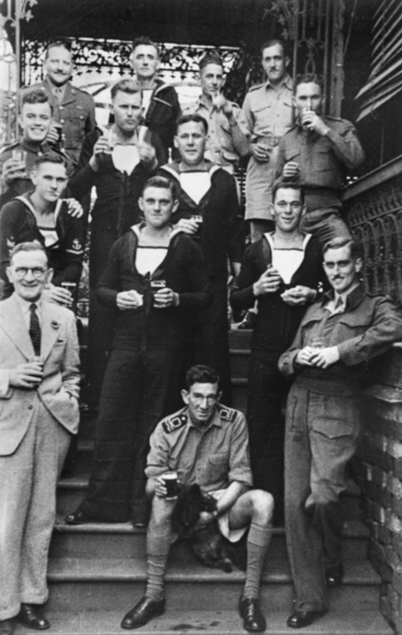 Informal group portrait of personnel connected with Operation Jaywick. Back row, left to right, Major (Maj) Herbert Alan Campbell (did not accompany the expedition); B/2575 Leading Stoker James Patrick McDowell, RN; unidentified; unidentified. Third row: Corporal R G Morris, RAMC; S/6543 Able Seaman (AB) Walter Gordon Falls, RAN; B/1506 Acting Leading Seaman Kevin Patrick Cain, RAN; 66175 Maj Ivan Lyon, MBE The Gordon Highlanders (officer commanding Operation Jaywick). Second row; S3428 Leading Telegraphist