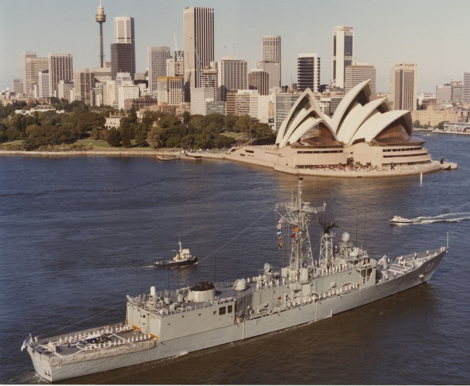 HMAS Sydney passes the Sydney Opera House on her way into Sydney Harbour.