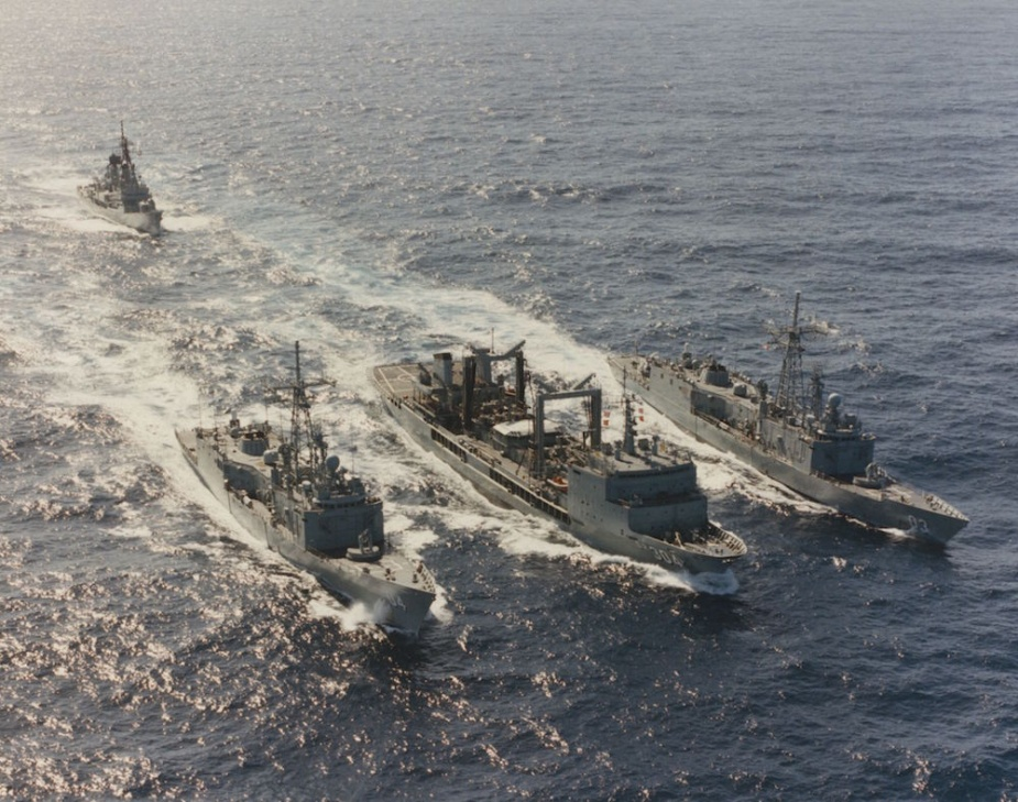 Sydney (far right) departs for RIMPAC 94 in company with HMA Ships Success (centre) and Darwin (left), and, in the background, HMAS Hobart.