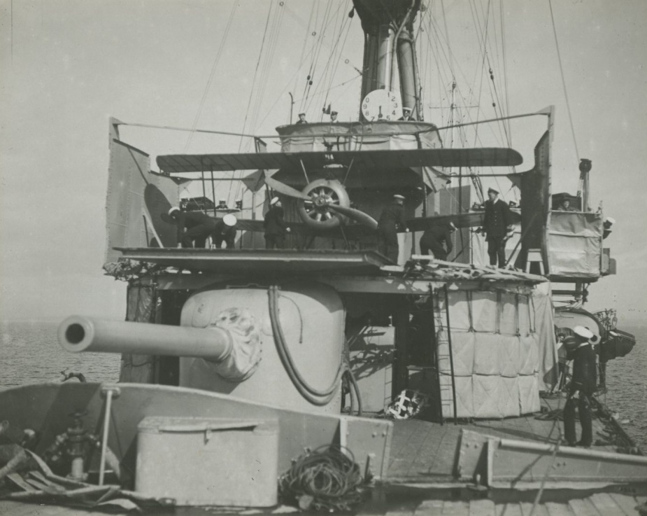 Sydney's aircraft mounted on the revolving catapult situated in front of her bridge