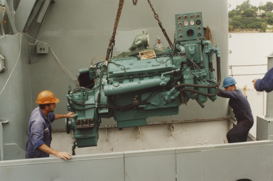 Installing a new starboard main engine at HMAS Moreton in January 1992