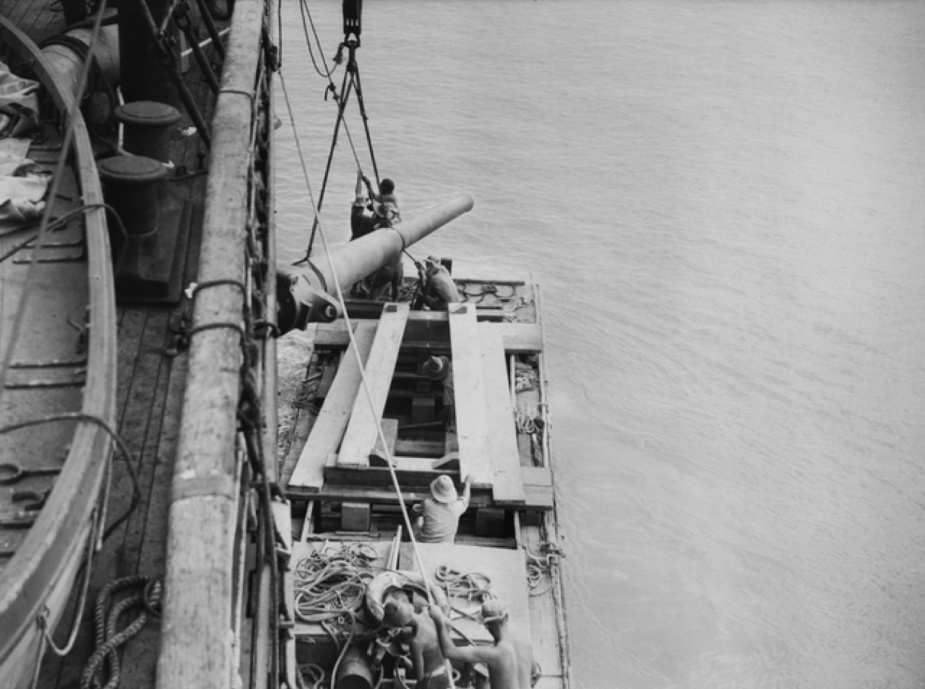 One of the 6-inch guns being taken ashore.