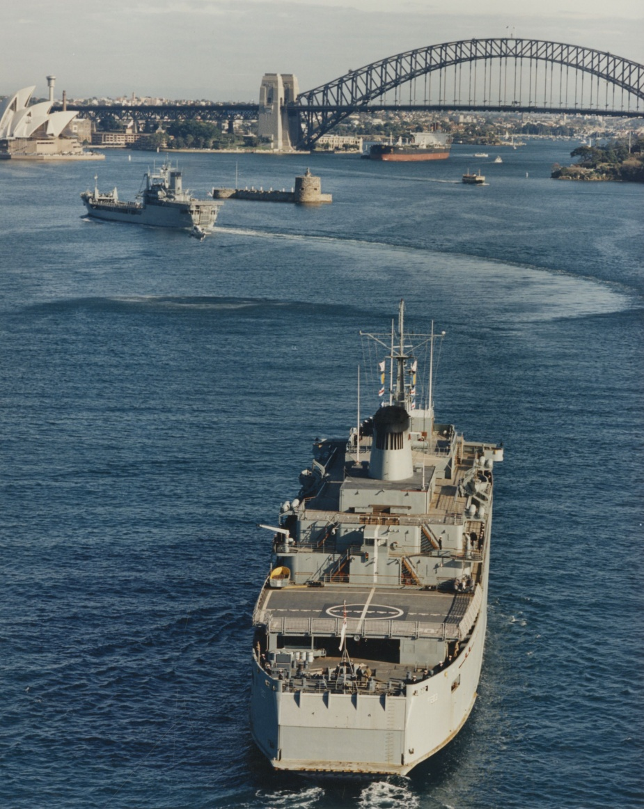 Tobruk leads Jervis Bay into Sydney following their withdrawal from Operation SOLACE.