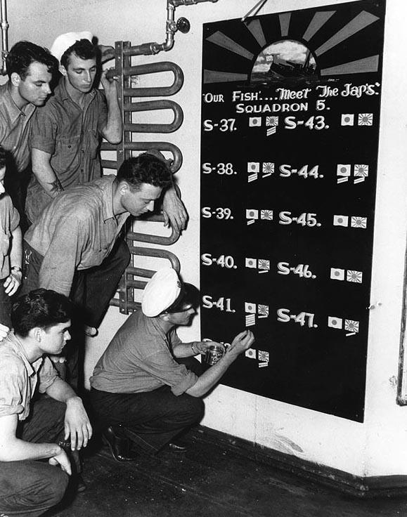 Sailors in the submarine tender USS Griffin update Submarine Squadron 5's scoreboard (USN #80-G-77065)