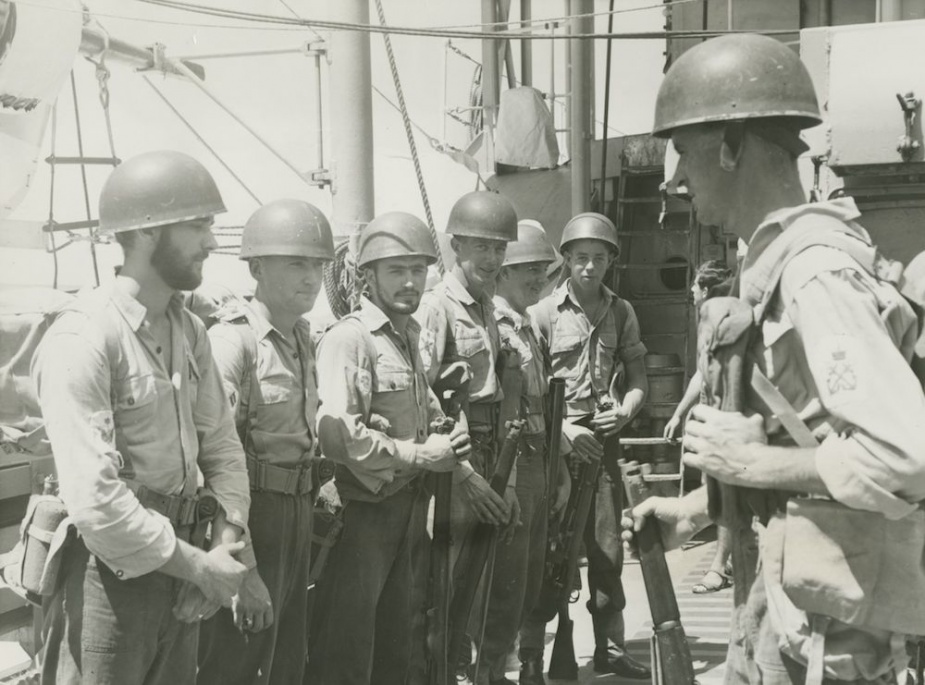 Petty Officer George Sewell briefing a landing party from Voyager during excercises in S E Asia. The party comprises L-R Brian Jackson, Douglas Bain, Reginald Stevenson, Ronald Williams, Edward Marschenko and Walter Priddle.