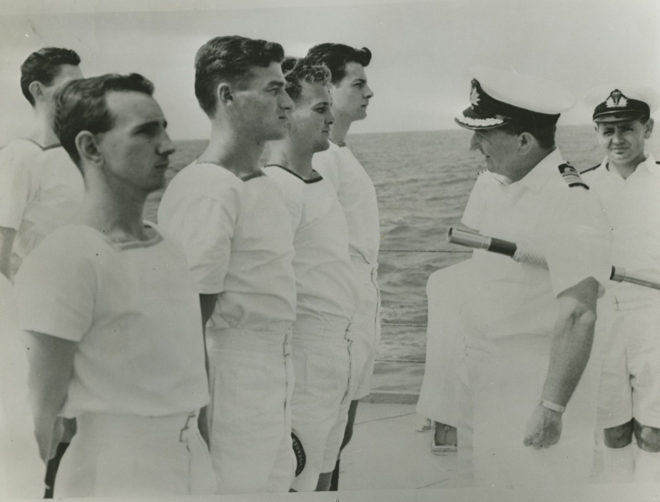 Captain Stevens inspecting members of Voyager's crew c.1963