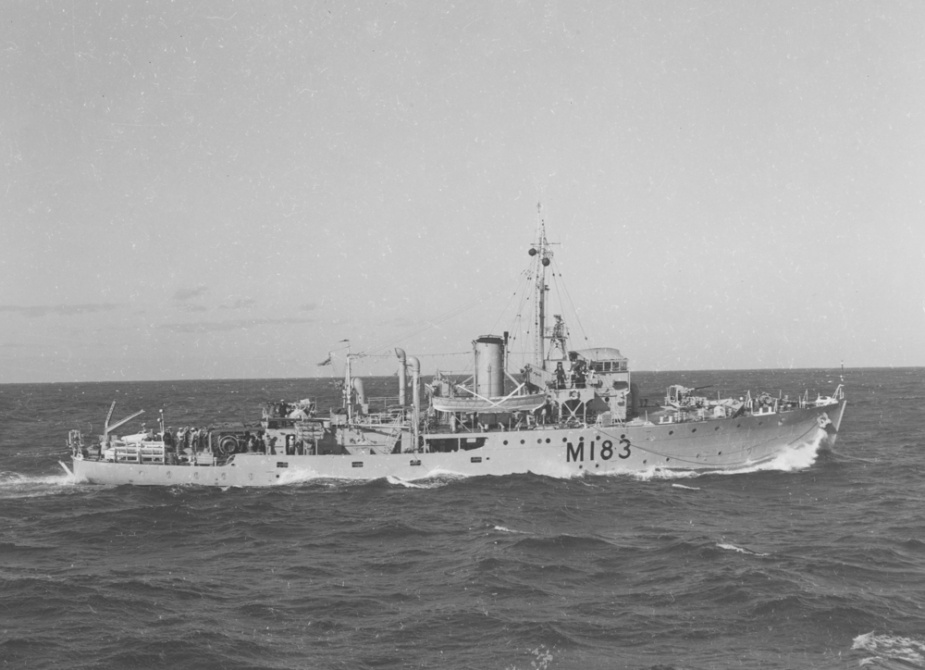 Wagga at sea wearing her post war pennant number M183.