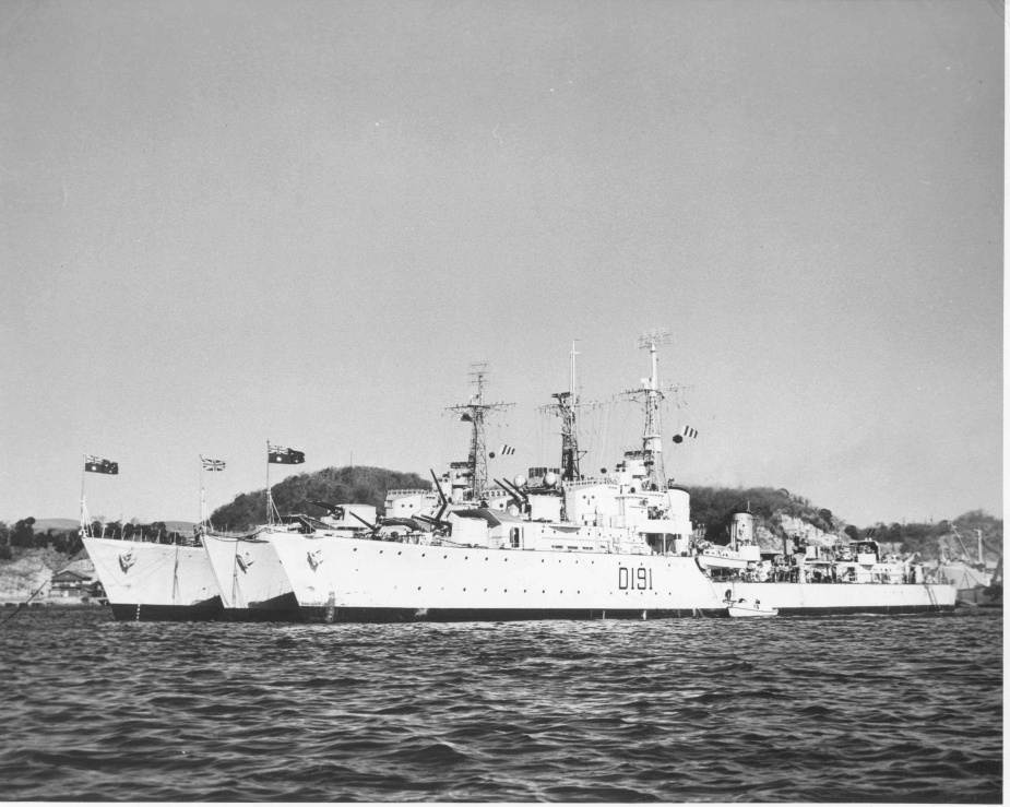Warramunga and Bataan flank HMS Charity in Yokosuka in January 1951.