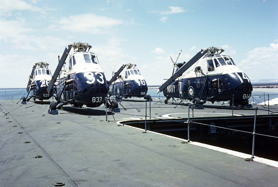 Sydney's embarked Wessex helicopters secured on deck.