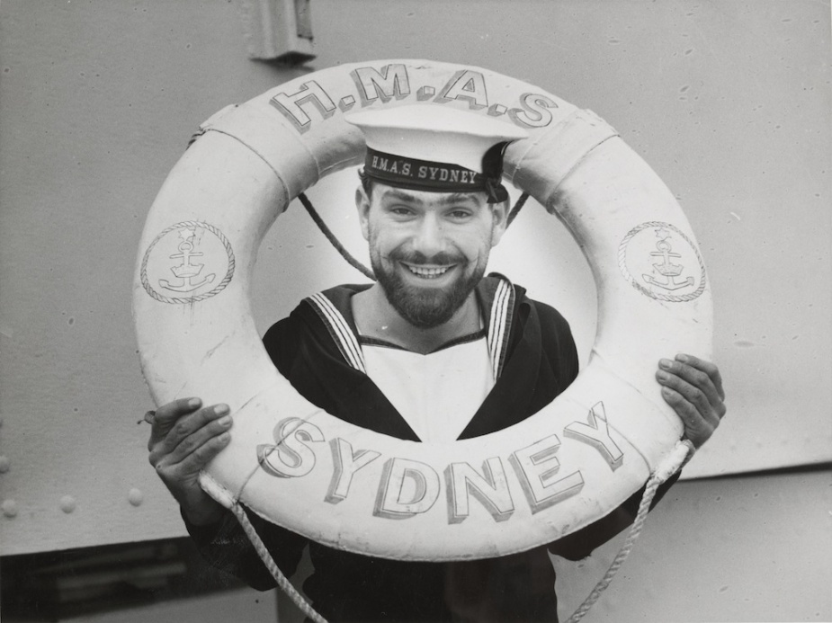 Able Seaman Jack Davenport poses whith one of Sydney's ceremonial life rings prior to the outbreak of WWII (State Library of Victoria)