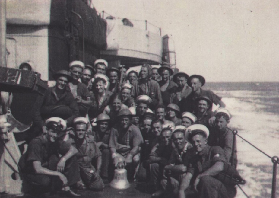 Survivors from HMAS Nestor onboard HMS Javelin with their salvaged ship's bell.