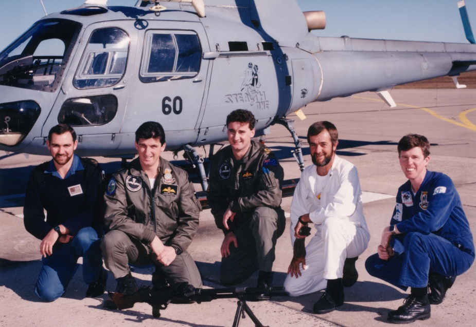 HMAS Sydney's embarked flight beside their aircraft during the First Gulf War.