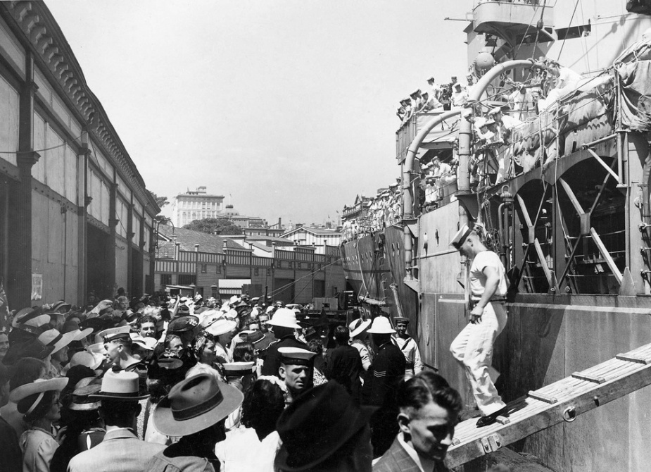 The scene on the wharf as HMAS Sydney crew members departed the ship