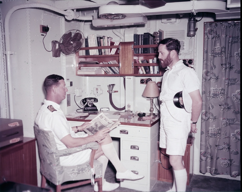 Captain R.J. Robertson, DSC, RAN in his day cabin circa 1958.