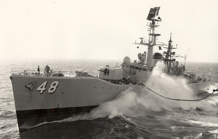 HMAS Stuart conducting a replenishment at sea. In 1969 she adopted a the new style pennant number '48' seen here.