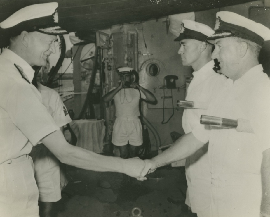 Admiral Sir David Luke (C-in-CFEF) arriving on board HMAS Voyager in 1963. He is pictured meeting Captain D.N. Stevens and Lieutenant D.J. Martin