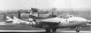 A RAN Sea Vampire on the ground at NAS Nowra. In the background is a Gannet.