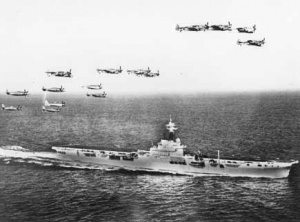 Sea Furies and Fireflies in formation over HMAS Sydney.