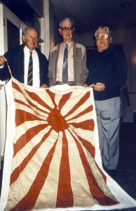 In 1994 the fake Japanese ensign was presented to the Australian War Memorial in Canberra. Seen here are Operation Mosquito veterans Marsden Hordern, 'Chips' Wood and D'Arcy Kelly.