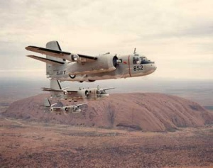 851 Squadron Trackers in flight over Uluru.