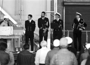 LCDR Jack McCaffrie, LEUT Jack Ryan, CMDR Rob Partington and CDRE Robert Loosli at the handover ceremony of replacement Trackers in the USA in 1977 following the hangar fire at NAS Nowra.