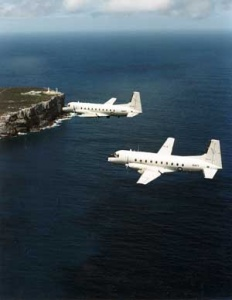 he RAN's two HS748s in flight over Point Perpendicular, Jervis Bay.