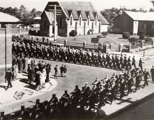 HMS Nabbington's ships' company marching through the streets of Nowra during their farewell parade in February 1946.